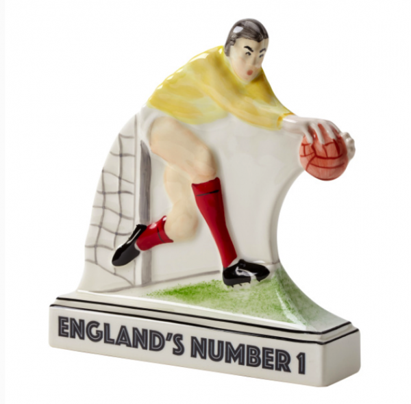 """A tribute to """"Englands number 1,"""" Gordon Banks OBE 2019. Limited edition of 66 only. Exclusive to Emma Bailey ceramics only. Hand painted and designed by Emma Bailey. 10% of sales go towards the Alzheimers society. 5% of sales go towards S.C.O.B.A. Please use the box provided if you require a certain number, at the moment numbers 1 - 10 will be gifted to the family of Gordon. A list of numbers sold will be printed underneath. Sold numbers 1-10 , 7, 59, 11, 66, 56, 33, 12, 8, 15 measures : 14.5 cm high 13.5 cm wide. material : earthenware made in Stoke-on-Trent.England. numbered on the base. Certificate of authenticity includes your edition number and Emma's signature. Fully gift boxed in eco- friendly packaging."""