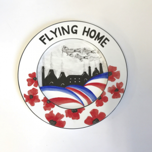 Flying home round plaque